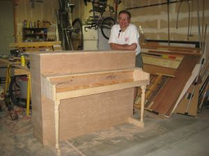 KellieAnn's Dad, Mark, stands proudly next to the stage piano his is in the process of building.